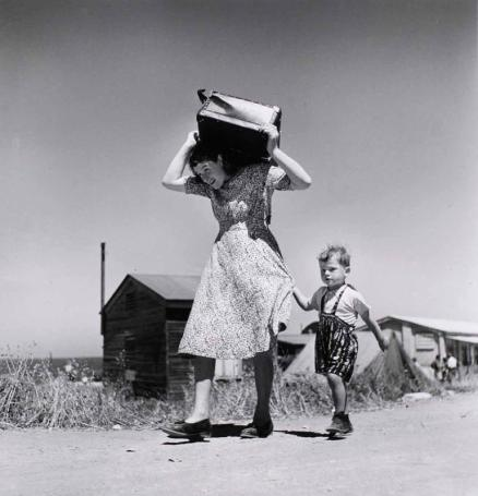 Robert Capawoman-carrying-luggage-accompanied-by-a-small-boy-haifa-israel-1949