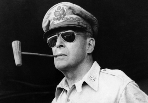 Douglas MacArthur smokes one of his favorite corn cob pipes on a ship bound for Luzon Island in the Philippines on Jan. 20, 1945. Five Star Insignia on his collar denoting him general of the Army. (AP Photo/Pool)